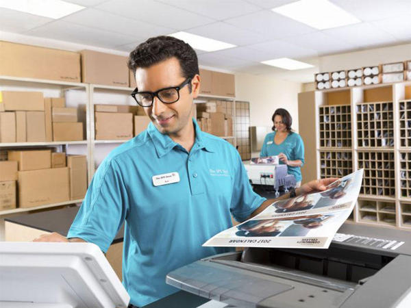 man standing at printer