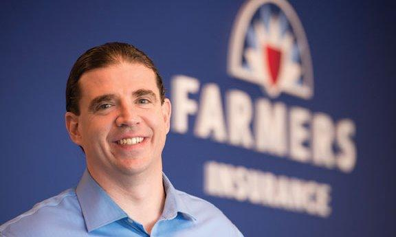 Agent Jeff in front of Farmers logo