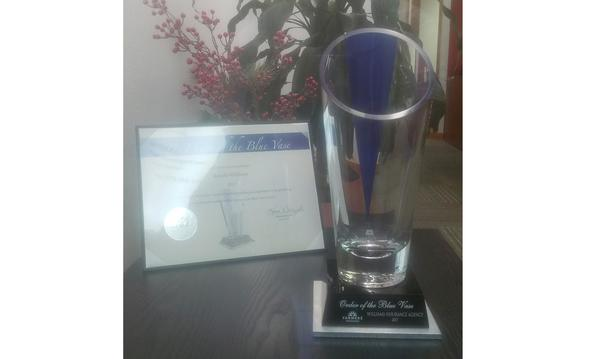 Farmers Blue Vase Award displayed on a table