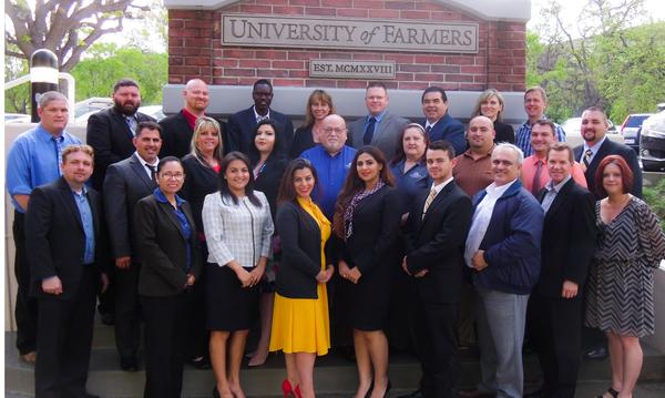 Farmers agents pose in front of Farmers University