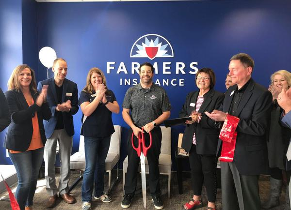 Ribbon Cutting at Grand Opening of new office