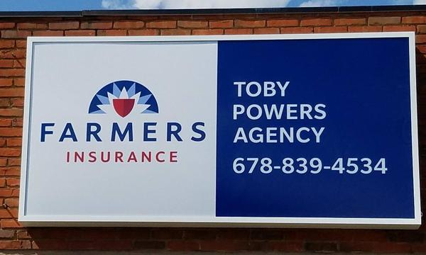 "A sign that reads, ""Farmers Insurance Toby Powers Agency 678-839-4534"""