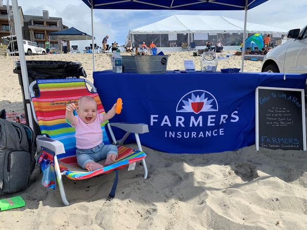 Baby at the beach by a Farmers Booth