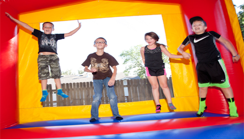 Kids bouncing on inflatable platform