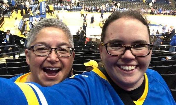 Agent with friend at Warriors game.