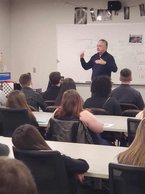 Frank is teaching business students at the Tulsa Technology Center