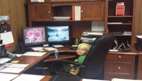 This is my Grandson Riah at work.  He is probably busy doing some quotes.