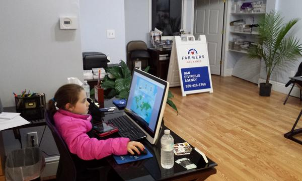 young girl on a laptop in the office
