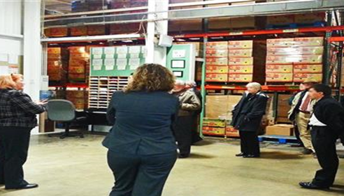 Agent Wes Kindelberger hears about good work at the Westmoreland Co. Food Bank