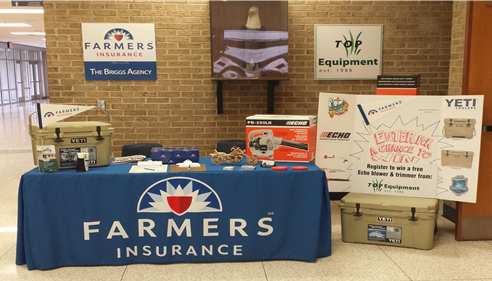 A booth set up for Farmers Insurance
