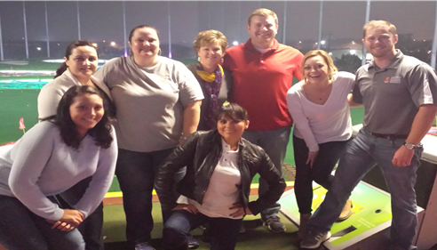 Celebrating an office achievement at Top Golf Austin Texas.