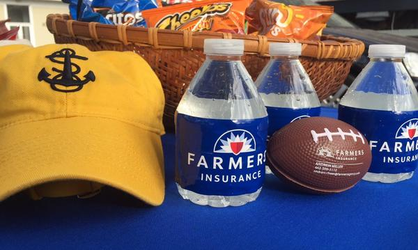 Farmers® branded water bottles and a small football