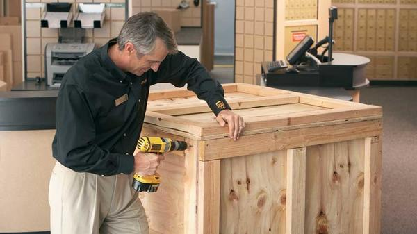 The UPS Store franchisee making a shipping crate