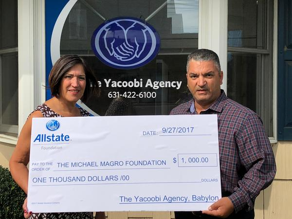 Zubin Yacoobi - Zubin presents $1,000 check to Terrie Magro, co-founder of the Michael Magro Foundation.