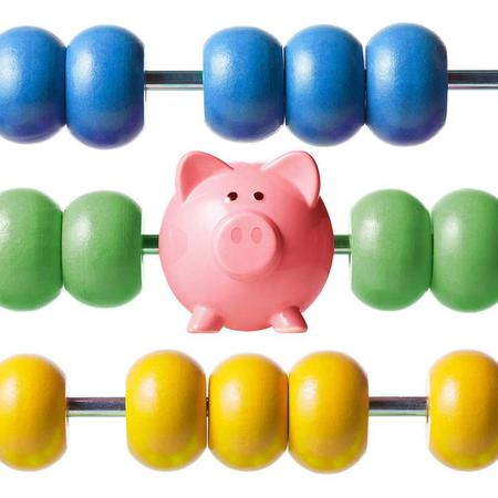 a piggy bank on an abacus