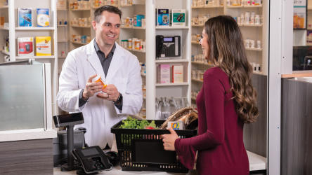 Pharmacist and customer talking at the Pharmacy counter.