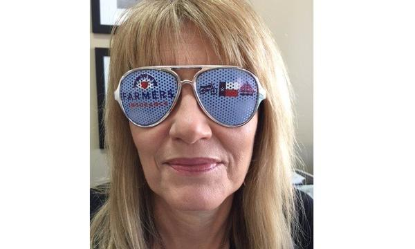 Alan Rhea Agency staff member wearing Farmers Insurance branded sunglasses.