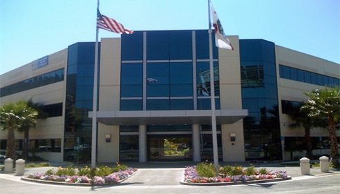 Exterior of office building with flags waving