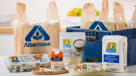 Albertsons Grocery bags, delivery box and groceries such as eggs, flour and cream.