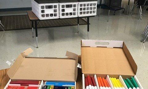 Photo of school supplies and colored markers.