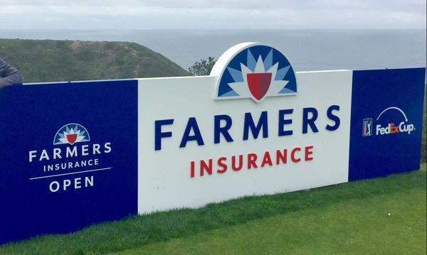 A Farmers sign at the Farmers Open Golf Tournament