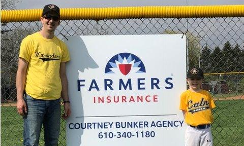 Courney Bunker Agency sign at a baseball game