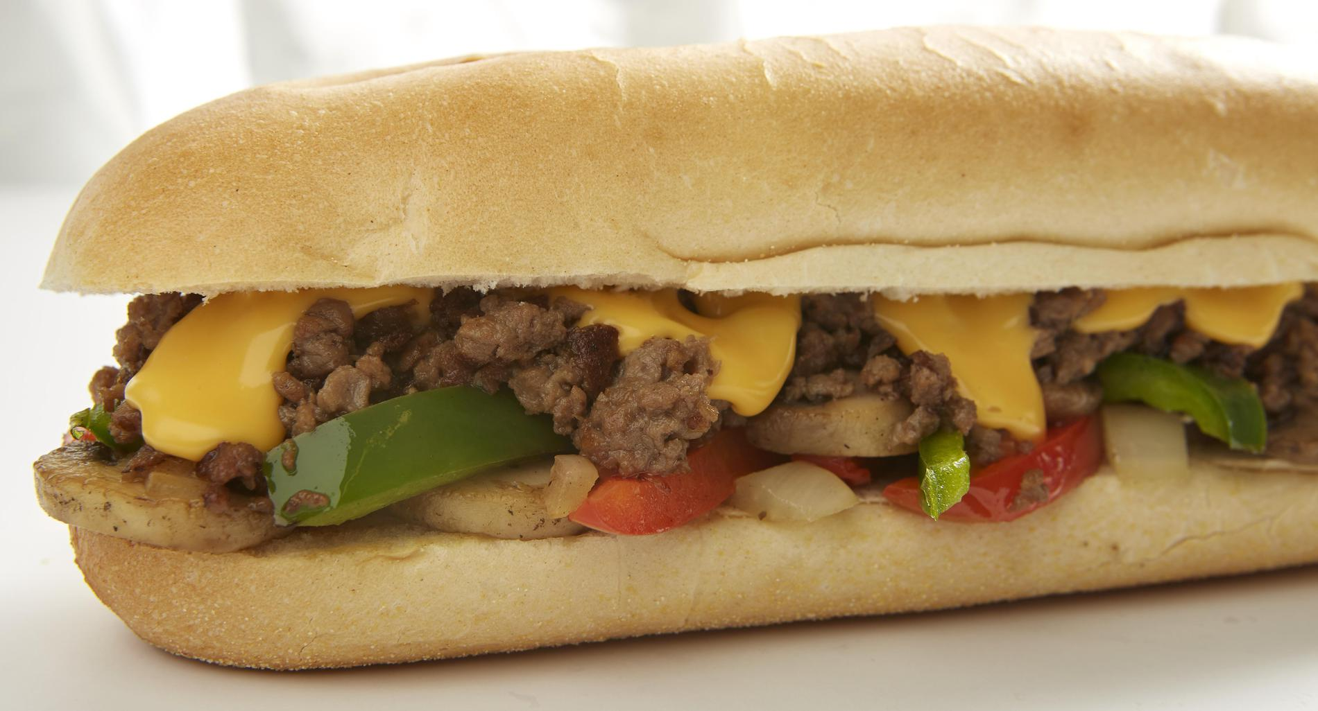 Cheesesteak sandwich with Impossible meat made from plants, mushrooms, onions, peppers & Cheez Whiz