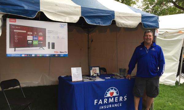 Agent at a Farmers booth