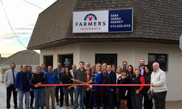 Farmers staff celebrating the grand opening with the Jackson Area Chamber of Commerce