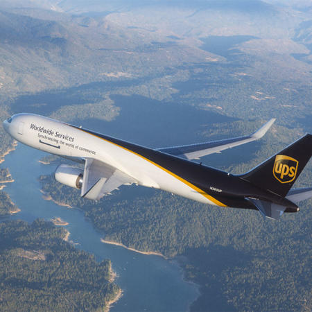 UPS delivery plane flying high above a river