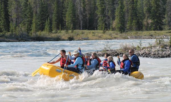 White Water rafting the Jasper River in Canada last summer trying to survive  Class 3 rapids!