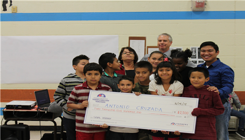 Thank a Million Teacher local grant Winner with his kids