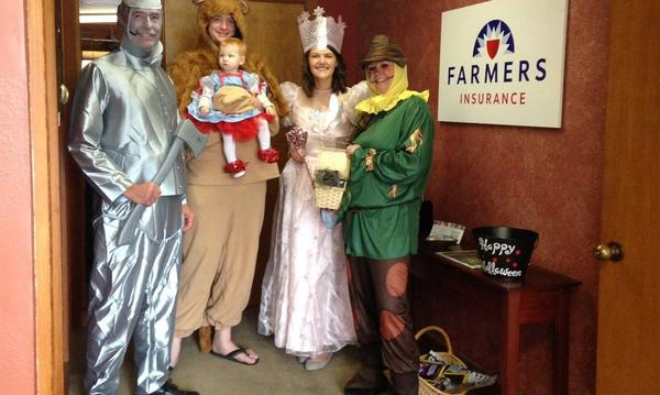 Group of people in Tin Man, Cowardly Lion, Fairy, and Scarecrow Costumes