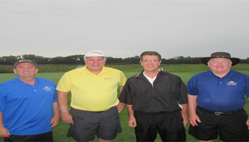 The local Farmers® men at a charity golf event, August 2014.