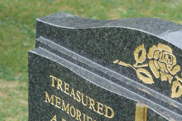 Granite headstone with a polished finish and gold leaf inscription