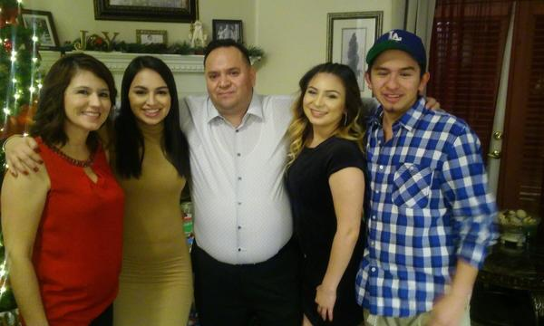 Agent Jose with his family, three women and a male.