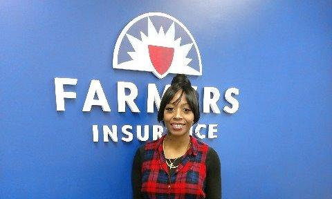 Bellus Academy Career Day winner Careess in front of Farmers insurance