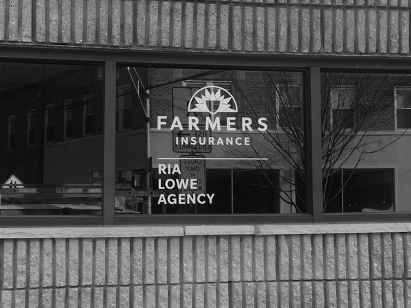 Black and white photo of the Ria Lowe Agency's storefront.