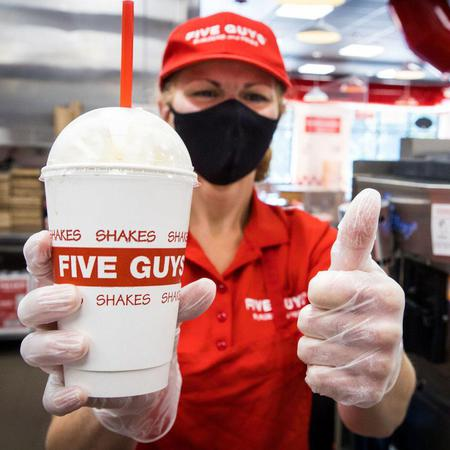 Five Guys employee with milkshake