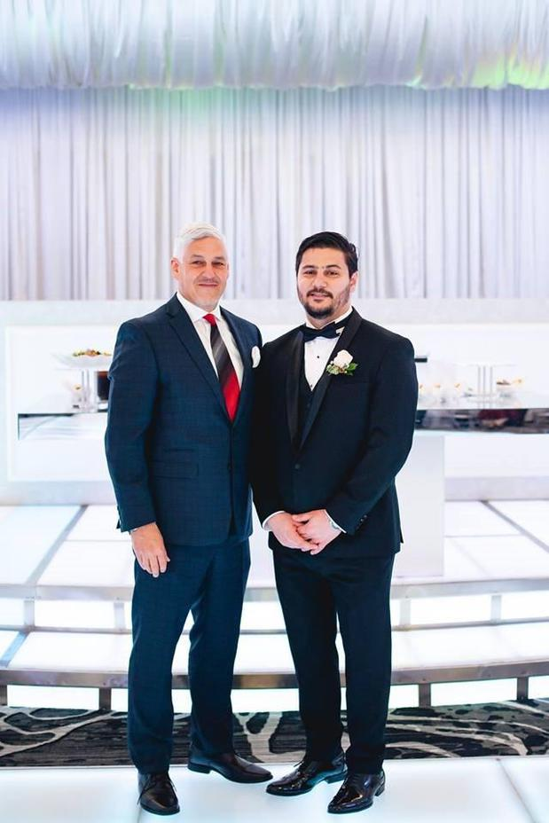 Father and son at a wedding