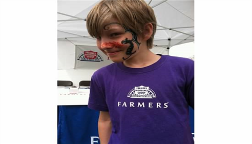 My face-painted son, Nathan, at the March of Dimes 5K, May 2013.