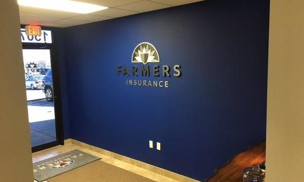 The Farmers logo on the wall of The Matt North Agency.