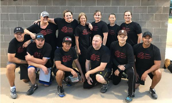 Group photo of the company softball team