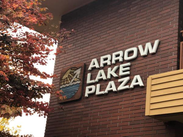 Sign that reads Arrow Lake Plaza