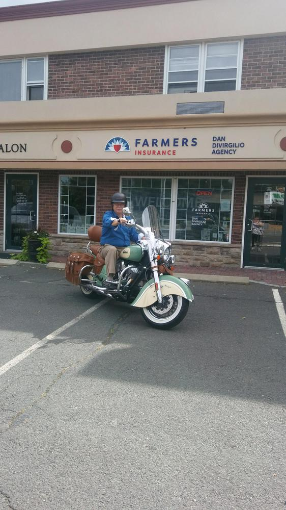 man on motorcycle in front of store
