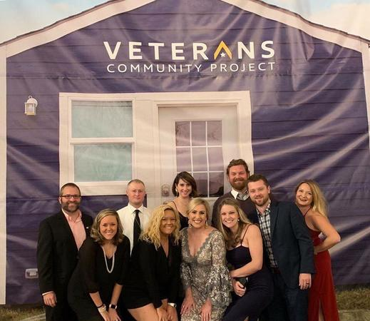 Posing for a picture at the Veterans Community Project Banquet