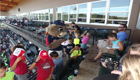 Rhubar entertains the kids at the game, hosted by the Dickson Agency.