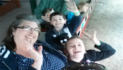 The family riding the log flume at Knoebel's amusement park