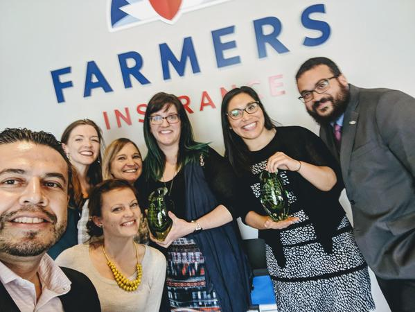 Farmers Agency staff with Green Vase award