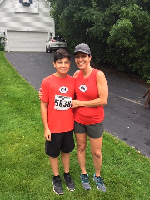 mother and son after a road running race